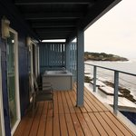 Balcony with jacuzzi overlooking the rocky shoreline