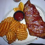 Half rack of pork ribs with fries