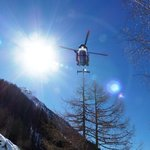 Helicopter lifting out an injured skier