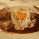 Spicy gulasch topped with egg