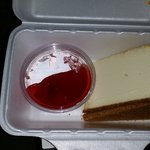 Cheese cake with strawberry topping, nice portion sized, thick lk new york style