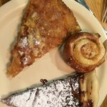 A slice of the apple cinnamon, a CINNAMON ROLL and a slice of the chocolate pizza
