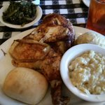 Baked chicken with dressing, creamed corn and turnip greens.