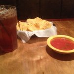 Big drink, chips and soupy salsa