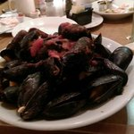 Mussels in red sauce. Best deal in town on Sunday only 8.00 for this plate. With bread. Get em s