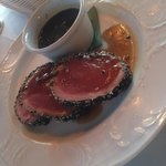 Tuna appetizer encrusted in sesame seeds and peppered to perfection