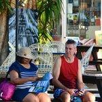 Sitting outside Rising Sun with Sarayi Manager, John