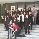 The staff posing for a picture