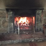 A cosy roaring fire to have dinner in front of on a cold wet evening