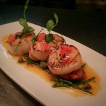 Pan seared black pearl scallops with a tomato and crayfish butter on a bed of samphire