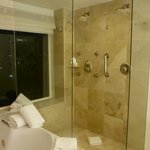 Shower next to jacuzzi with beahc view