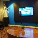 Lobby lounge for HDTV viewing w. comfortable sofa & chairs