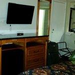 Flatscreen TV and adequate channels; decent-size refrigerator