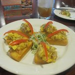 Appetizer of ackee and salt fish on fried bammy