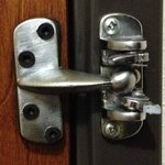 Busted-off night security latch on the room door