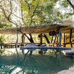 Singita Boulders Lodge swimming pool and dining deck