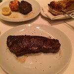 Prime new york strip, filet and lobster tail and Flemings potatoes