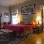 The Presidents' Room, a spacious, sunny guest room, king bed and private bath
