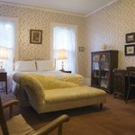The Worlds' Fair Room, a sun-filled, restored guest room, queen bed, private bath