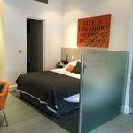 Superior studio sleeping area & bathroom