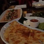 Quesadilla, ample edamame, and chicken pizza on happy hour