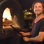 Our pizza coming out of the pizza oven