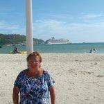 Diane in front of Honky Tonk Bar (Carnival Splendor in the background)