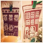 Handmade faux gingerbread ornaments depicting local neighborhood row homes in our gift shop