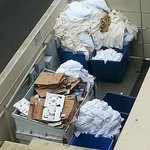 Dirty Laundry stored by recycle bin until ready to wash. View from balcony