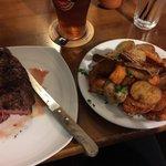300 gram steak, and potato and sweet potato side dish.
