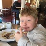 My grandson eating his pancakes at Ena