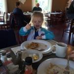 My granddaughter having her pancakes at Ena