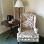 Chair and table located in the room