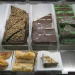 Various kinds of chocolate cake slices, and a sausage wrap (bottom center)