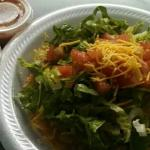 This is a bean tostada from Munchy's next to the green and mild sauces that they have. My favori