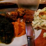 Family style plate of tandoori chicken, korma, saag, chicken and shrimp biriyani and naan bread