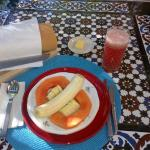 Part I of one of my breakfasts - fresh tropical fruit plate, juice, bread
