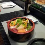 bowl of selected nigiri and raw fish
