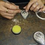 Assembling a silver filigree pendant