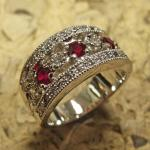 Original 14k white gold lady's ring set with genuine rubies and diamonds