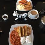 Poached Eggs and Beans on brown seeded toast and Scrambled Eggs and Beans on Toast with a sausag