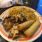 Lo mein, teriyaki chicken, and spring rolls.