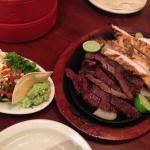 Sizzling Mixed Fajitas, sides and Warm, Soft Flour Tortillas!