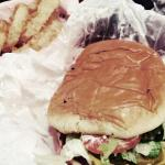 Cheese burger with everything on it. Homemade onion rings with homemade salad dressing. A must t