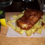 Overcooked fish with undercooked chips. Rock hard mushy peas and fine heinz ketchup