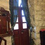 In the room on the 2nd floor - VERY tall ceilings - stone walls