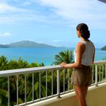 Woman on Coral Sea View balcony