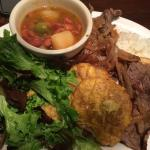 Bistec combo (small). Fresh greens, plantains, thinly sliced steak with grilled onions, pink bea