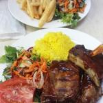 Half-rack ribs with rice and salad $35 (the extra plate of chips and salad was $8 extra)