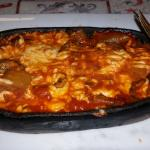 mushrooms and cheese in clay pot
